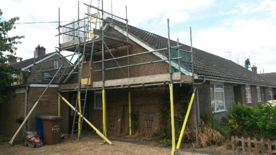 Scaffolds for roof extensions